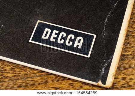 LONDON UK - JANUARY 4TH 2017: A close-up shot of the Decca Records symbol on the corner of a vintage vinyl record cover on 4th January 2017. Decca Records began as a British label in 1929.