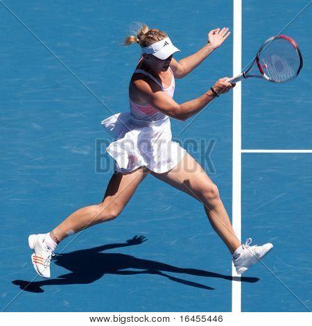 MELBOURNE - JANUARY 27: Caroline Wozniacki of Denmark plays in her semi final loss to Li Na of China in the 2011 Australian Open on January 27, 2011 in Melbourne, Australia