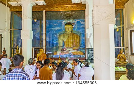 ANURADHAPURA SRI LANKA - NOVEMBER 26 2016: The statue of Touching Earth Buddha decorates the Image House of Bodhi Tree Temple on November 26 in Anuradhapura.