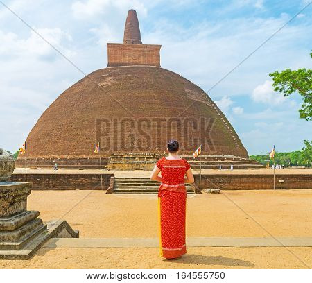 The tourist watches the giant Abhayagiri Stupa one of the famous archaeological sites and functioning monastic complex Anuradhapura Sri Lanka.