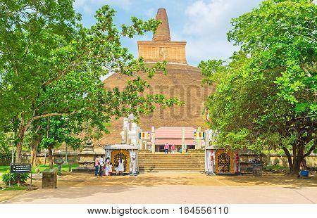 ANURADHAPURA SRI LANKA - NOVEMBER 26 2016: The main entrance to Abhayagiri Vihara important monastic complex among the Buddhist worshipers on November 26 in Anuradhapura.