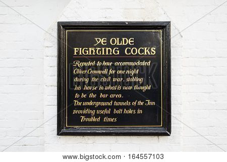 ST. ALBANS UK - JANUARY 5TH 2017: An information board at Ye Old Fighting Cocks public house in St. Albans detailing the history of the inn on 5th January 2017.