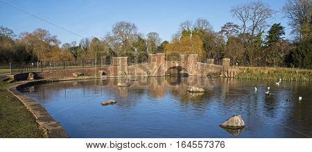 A view of the bridge over the lake in Verulamium Park in the beautiful city of St. Albans England.