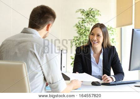 Guy giving a curriculum vitae to his interviewer in a job interview