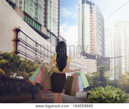 Asian Woman With Many Shopping Bag