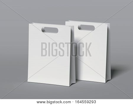 Two white blank shopping bags on gray floor. 3d rendering
