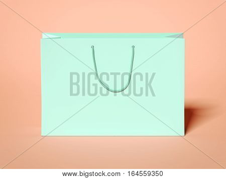 Green shopping bag with black handles on peach floor. 3d rendering