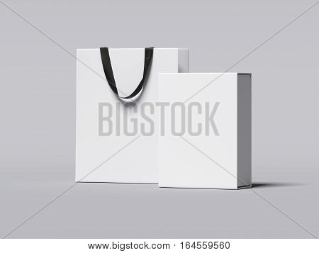 White box and luxury shopping bag on gray floor. 3d rendering
