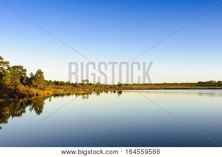 The lake at the Phukradung nation park before the sunset with the blue sky