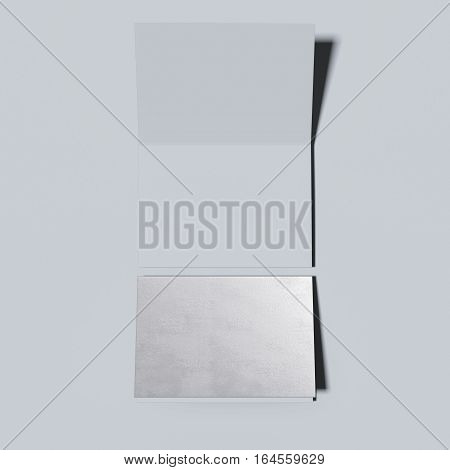 Silver closed and opened leaflets on a gray floor. 3d rendering