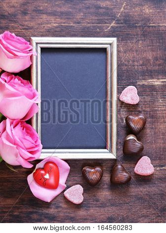 Pink rose flowers, frame for text and hearts for Valentines holiday