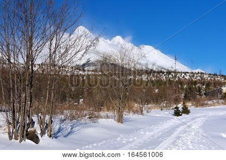 View of the High Tatras mountains with the peaks covered with snow from Horny Smokovec. Is a ski village located in Slovakia at an altitude of 950 m a.s.l.