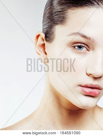young sweet brunette woman close up isolated on white background, perfect pure innocense freshness face, spa healthcare people concept copyspace