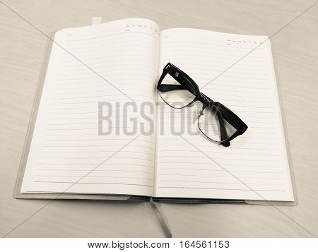 the notebook and glasses readly to meeting