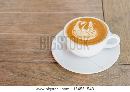 Close Up White Cup Of Coffee, Latte With Beautiful Latte Art On The Wooden Table.
