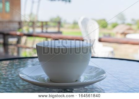 Close Up White Cup Of Coffee, Latte With Beautiful Milk Foam On The Glass Table.