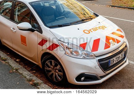 STRASBOURG FRANCE - DEC 1 2016: CPeugeot car with Orange Telecom Mobile logotype parked in city