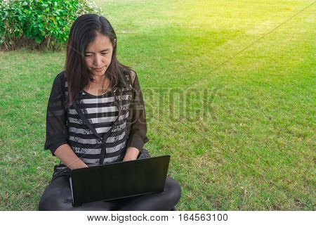 Beautiful Asian Woman Working Project Analysis Plans With Generic Design Laptop. Smart Work Process