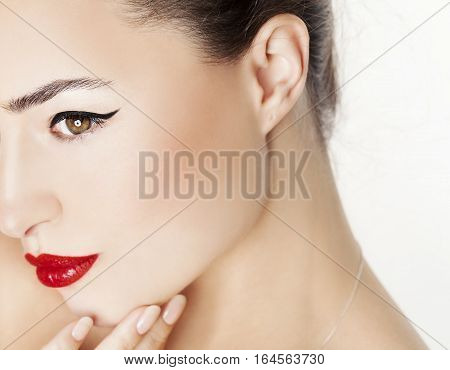 half portrait of a woman face with red lips