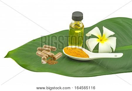 White frangipani flowers (Plumeria spp flower Apocynaceae flower Pagoda tree flower Temple tree flower) turmeric powder in white spoon and massage oil in green leaf isolate on white background.Saved with clipping path