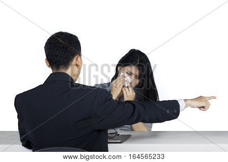 Photo of a female worker looks crying after expelled by her boss isolated on white background