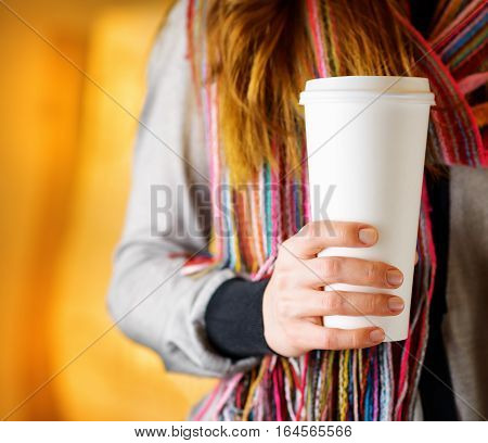 Young Woman Holding A Tumbler Of Coffee In Cafe