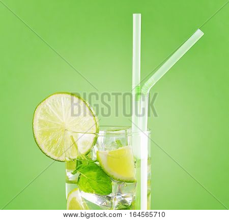 Glass Of Mojito Cocktail On Pastel Green Background