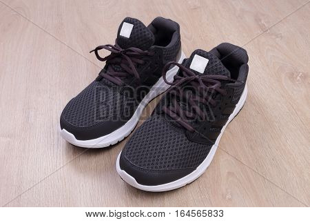 New black sport shoes on wooden background