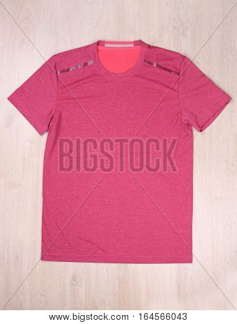 Front view sport tshirt on wooden background