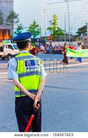 Korean Policeman Police Rear Directing Traffic