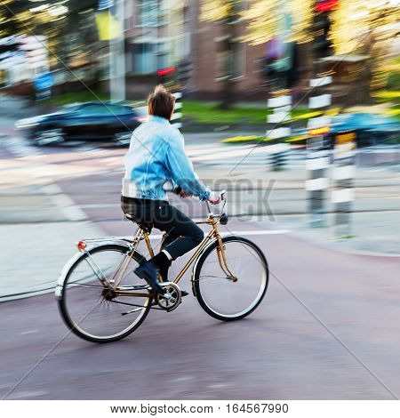 Bicycle Rider In City Traffic In Motion Blur