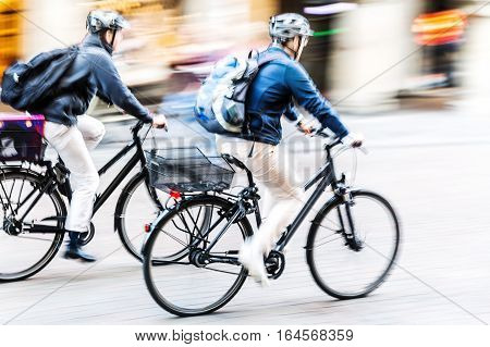Bicycle Riders In City Traffic In Motion Blur