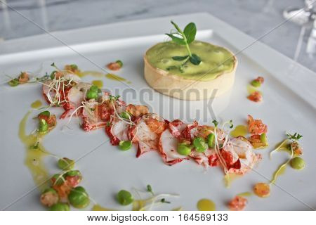 Lobster and green pea tart with fresh salad