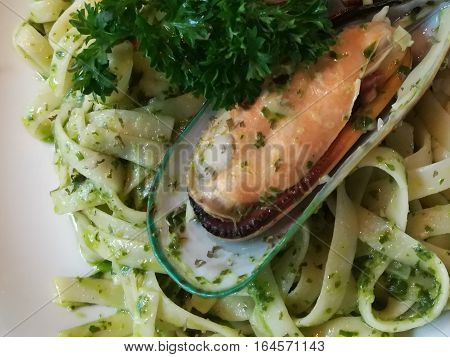 fettuchini pesto seafood on white plate at the restaurant