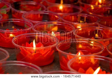 Red lotus shaped candles at chinese buddhist temple