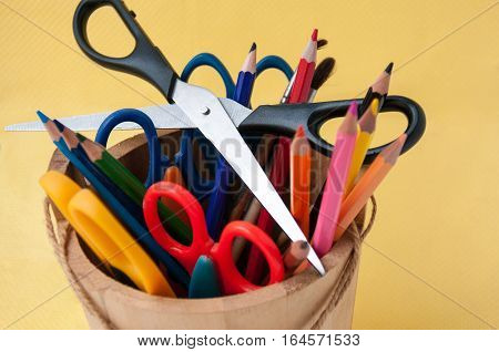 Scissors On Colored Pencils In A Wooden Pail Ножницы на разноцветных карандашах в деревянном ведерке