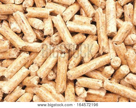 Texture of wooden pellets alternative energy concept image