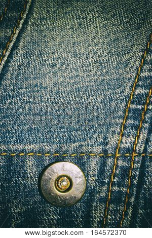 Blue jeans texture background and button and seam