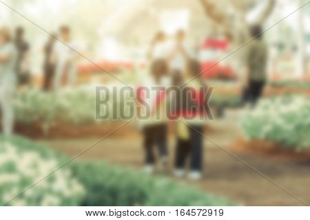 Blurred photo of kids walking in flower park farm
