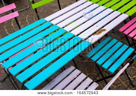 old and colorful coffee tables and chairs