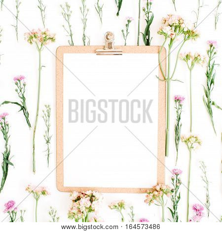 Clipboard mockup and wildflowers pattern. Flat lay top view