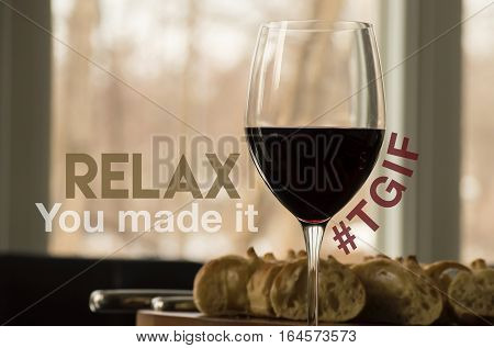 "Relax it's the weekend TGIF red wine social image with words written ""Relax, you made it"" and hashtag #TGIF around healthy red wine and cheese platter"