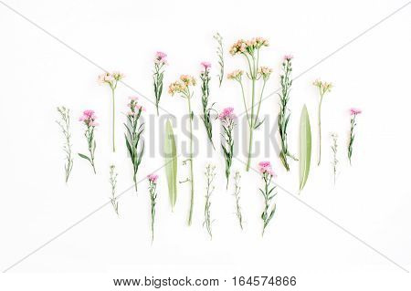 Creative wildflowers arrangement on white background. Flat lay top view. Valentine's background