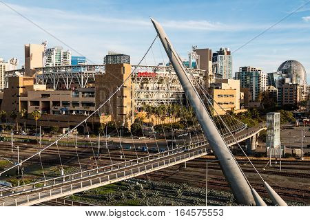 SAN DIEGO, CALIFORNIA - JANUARY 8, 2017:  Petco Park baseball stadium with the Harbor Drive pedestrian bridge, one of the longest self-anchored pedestrian bridges in the world.