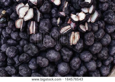 The fresh water chestnut (singhada or songoda) isn't a fruit but a knobby vegetable with a soft spongy stem that grows in the marshes. The inside is white tender and has a watery yet crunchy core.