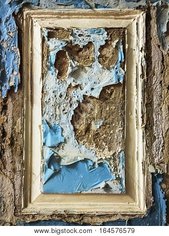 Peeling wall paint is framed in a back section of a building in Mumbai.