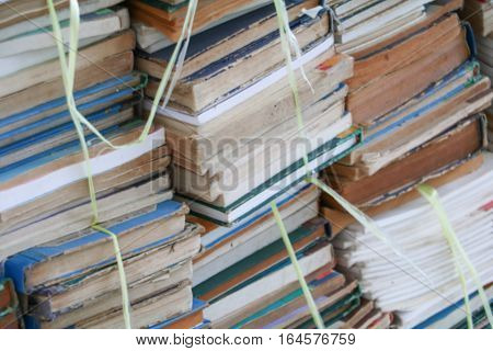 Blurred focus with Stack of Used Old Books in the School Library