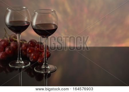 Valentines Day with a glass of red wine grapes.