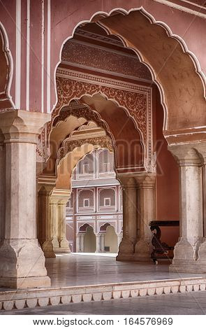 A series of arches leads through the central pavilion of the City Palace in Jaipur India.