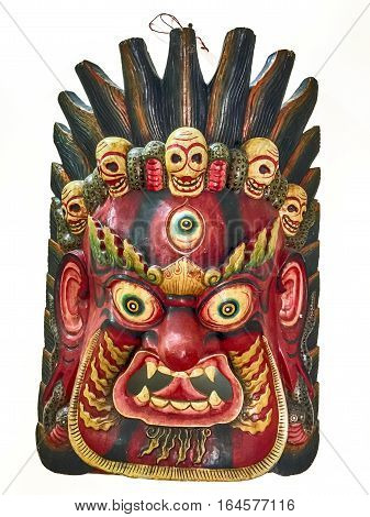 The mask for the Hindu god Mahakala has three eyes and five skulls. He is the consort for Kali and is considered to be a dharamapala or protector deity.